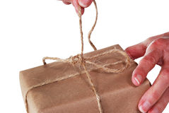 Untying string on package Royalty Free Stock Image