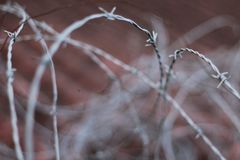 The unusable barbed wire of the roof. royalty free stock photography