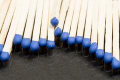 Unused matches with blue head screw Stock Photography