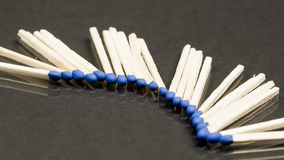 Unused matches with blue head screw Royalty Free Stock Image