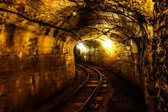 Unused mining tunnel view. Old mining tunnel interior view Stock Photography