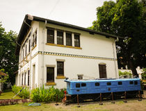 The unused old blue train near white building at Lawang Sewu photo taken in Semarang Indonesia Stock Photography