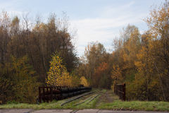 Unused railway crossing. In a picturesque autumn scenery Royalty Free Stock Photo