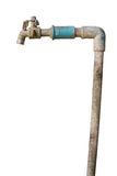 Unused very old faucet isolated Royalty Free Stock Images