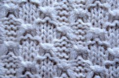 Unusual Abstract beige knitted pattern background texture. Close up Stock Photos