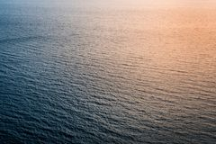 Unusual and abstract reflections of sunlight on sea surface Royalty Free Stock Photo