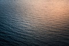 Unusual and abstract reflections of sunlight on sea surface Stock Photo