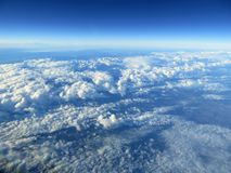 Unusual aerial view of mountains and sky. Stock Images