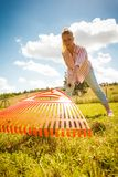 Unusual angle of woman raking leaves stock images