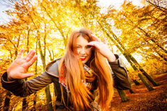 Unusual angle of young woman in autumn park Stock Images