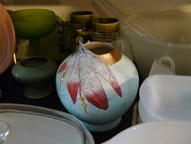 Unusual antique vase with feathers on display Royalty Free Stock Photography