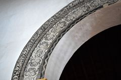 Unusual arch decorated by skull in San Antonio church  in Frigiliana - Spanish white village Andalusia Stock Photo