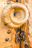 Unusual arias horn door knob with lock chains Stock Photos