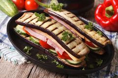 Unusual aubergine sandwich with vegetables, ham and cheese Royalty Free Stock Photo