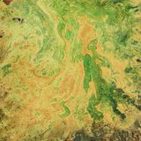An unusual background with orange and green divorces. Blots and stains. An unusual background with orange and green divorces. Blots and stains, square stock images