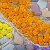 Unusual Beautiful garden stones and flowers background Stock Photography