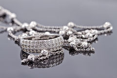 Unusual beautiful silver chain and a silver ring with gems Stock Image
