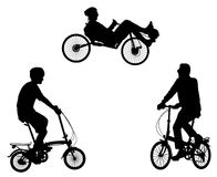 Unusual bicyclists silhouettes Royalty Free Stock Photo