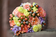 Unusual bouquet in orange yellow violet tones. Stock Image