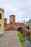 An unusual bridge in the Italian town of Comacchio. Unusual historic bridge in the Italian town of Comacchio Royalty Free Stock Image
