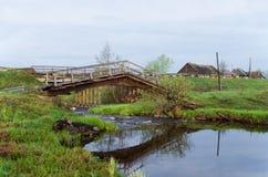 The unusual bridge through the river Stock Photos
