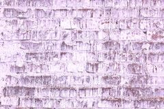 Abstract purple background from old brick wall in retro style royalty free stock image