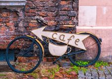 Unusual cafe signboard on bicycle. Signboard shop or restaurant.  royalty free stock image