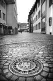 Black and white city street view with beautiful carved manhole, Freiburg im Breisgau, Germany stock photo