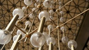 Unusual chandelier design inside of National Palace of Culture in Sofia Bulgaria. Stock footage stock video