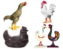 Unusual Chicken Collection. A wind up rooster, a chocolate hen, two Swedish folk art chickens, and a rough and ready barnyard rooster royalty free illustration