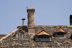 Unusual chimney. Chimney unusual shape on a tiled roof Royalty Free Stock Photos