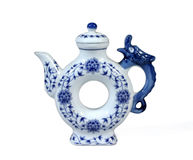 Unusual China teapot. Unusual donut shaped China teapot with a dragon shaped handle Royalty Free Stock Image