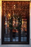 Unusual christmas wreath on window. luxury decorated store front stock photography