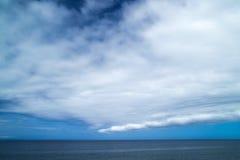 Unusual cloud formation over ocean Stock Photos