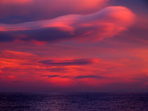 Unusual cloud over sea. Stock Photo