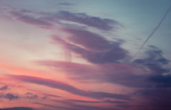 Unusual Clouds. Beautiful Cloudscape At Sunrise In Pink and Blue Royalty Free Stock Image