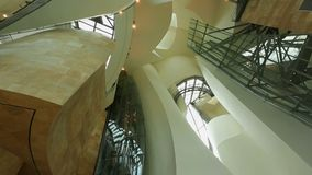 Unusual and contemporary interior design of Guggenheim museum in Bilbao, Spain. Stock footage stock video footage