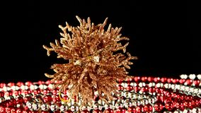 Unusual coral toy for Christmas or New Year and. Unusual shiny coral toy for Christmas tree for decoration Christmas or New Year and red and white beads stock video footage