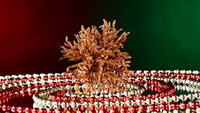 Unusual coral toy for Christmas or New Year and. Unusual shiny coral toy for Christmas tree for decoration Christmas or New Year and red and white beads stock footage