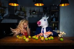 Unusual couple at bar counter in stylish kitchen royalty free stock images