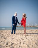 Unusual couple have marriage on the beach. royalty free stock photography