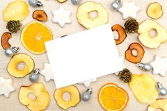 Unusual creative Christmas and New Year greetings template with. Dried ts, cookies and Christmas decorations on the rustic wooden table Stock Photography
