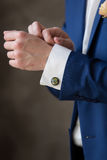 Unusual cufflinks groom. Cufflinks groom a peacock feather Royalty Free Stock Images
