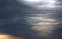Unusual dark gray stratus clouds. Aerial view, skyscape stock photo