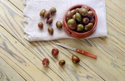 Varietal tomatoes on a wooden background Royalty Free Stock Image