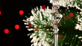 Unusual decoration - a crystalline toy hanging on. Unusual christmas decoration - a crystalline toy hanging on christmas tree, bokeh, light, on black background stock video footage