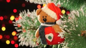 Unusual decoration like teddy - a toy on christmas stock video
