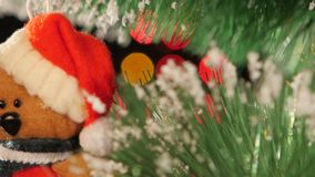 Unusual decoration like teddy - a toy on christmas stock footage