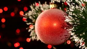 Unusual decoration - a round red toy on christmas stock video footage