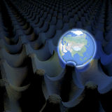 Unusual depiction of glowing planet earth in an egg carton box, asia in view Stock Photography